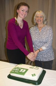 Jenny Smith and Annette Scobie cut the anniversary cake